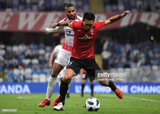 Tomoaki Makino of Urawa Reds and Mohamed Aoulad Youssef of Wydad Casablanca during the FIFA Club World Cup UAE 2017 fifth place playoff match between...