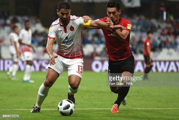 Tomoaki Makino of Urawa Reds and Youssef Rabeh of Wydad Casablanca battle for the ball during the FIFA Club World Cup UAE 2017 match between Wydad...