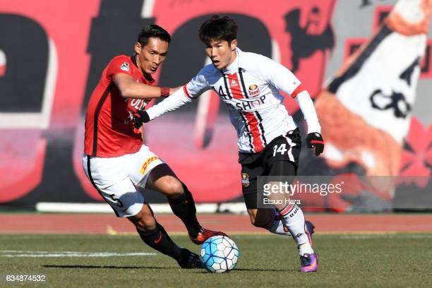 Tomoaki Makino#5 of Urawa Red Diamonds and Cho Chan Ho#14 of FC Seoul compete for the ball during the preseason friendly between Urawa Red Diamonds...