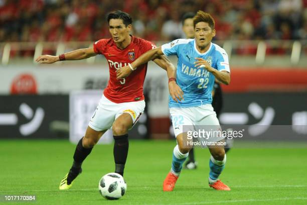 Tomoaki Makino#5 of Urawa Red Diamonds and Yoshito Okubo#22 of Jubilo Iwata compete for the ball during the JLeague J1 match between Urawa Red...