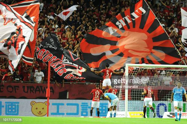 Tomoaki Makino#5 of Urawa Red Diamonds celebrates scoring his team's third goal during the JLeague J1 match between Urawa Red Diamonds and Jubilo...