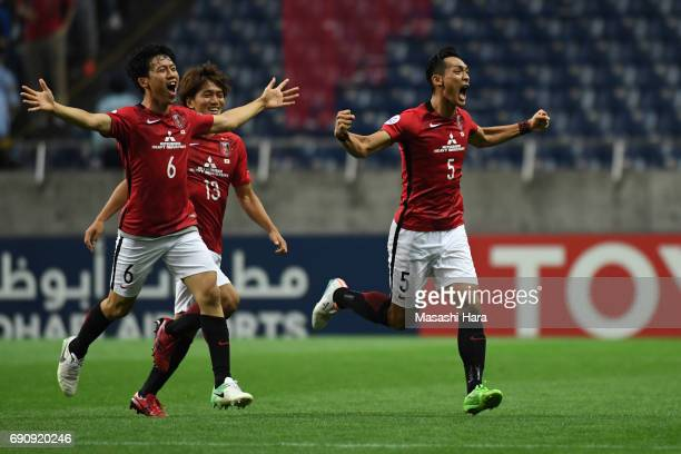 Tomoaki MakinoToshiyuki Takagi and Wataru Endo of Urawa Red Diamonds celebrate the win after the AFC Champions League Round of 16 match between Urawa...