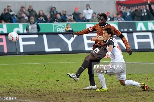 Tomoaki Maskino of Koeln and Gerald Asamoah of St Pauli during the Bundesliga match between FC St Pauli and 1 FC Koeln at Millerntor Stadium on...
