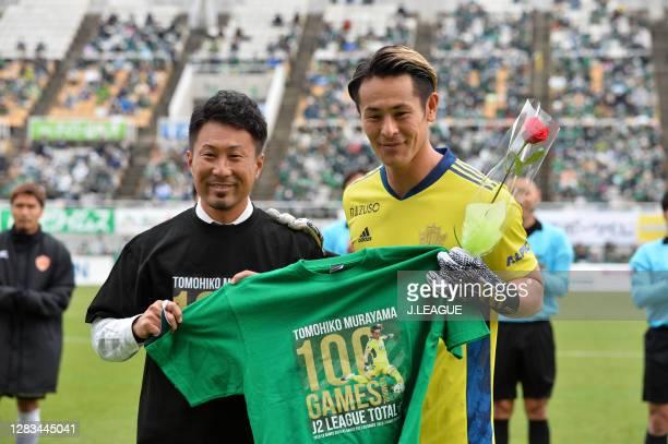 Tomohiko MURAYAMA of Matsumoto Yamaga celebrates marking his 100th appearance of J.League J2 match during the J.League Meiji Yasuda J2 match between...