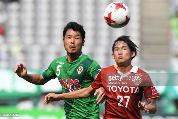 Tomohiro Taira of Tokyo Verdy and Koki Sugimori of Nagoya Grampus compete for the ball during the J.League J2 match between Tokyo Verdy and Nagoya...
