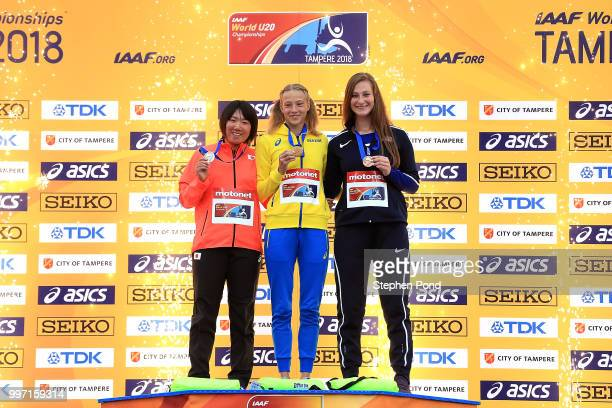 Tomoka Kuwazoe of Japan Alina Shukh of Ukraine and Dana Baker of The USA pose with their medals during the medal ceremony for the final of the...