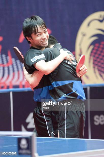 Tomokazu Harimoto and Yuto Kizukuri of Japan celebrate after winning the men's doubles semifinal match against Fan Zhendong and Xu Xin of China on...