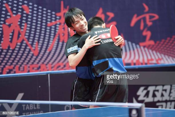 Tomokazu Harimoto and Yuto Kizukuri of Japan celebrate after winning the men's doubles semifinal match against Fan Zhendong and Xu Xin of China on...