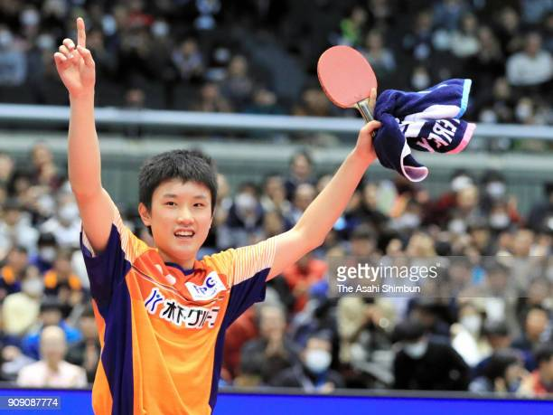 Tomokazu Harimoto applauds fans after winning against Jun Mizutani in the Men's Singles final during day seven of the All Japan Table Tennis...