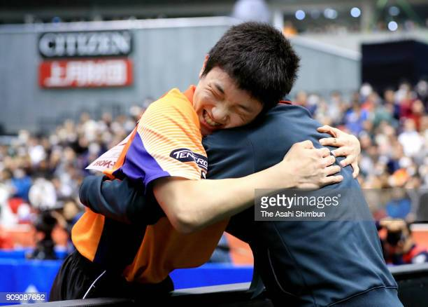 Tomokazu Harimoto celebrates winning against Jun Mizutani in the Men's Singles final with his father and coach Yu Harimoto during day seven of the...