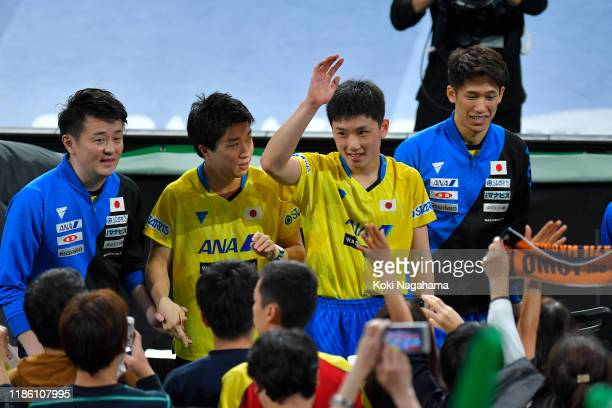 Tomokazu Harimoto, Maharu Yoshimura and Koki Niwa of Japan acknowledge fans after winning Men's Teams - Quarterfinals on day two of the ITTF Team...