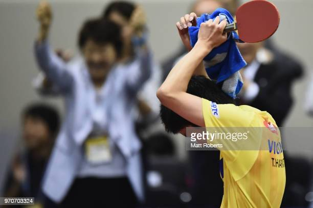 Tomokazu Harimoto of Japan celebrates victory against Jike Zhang of China during the men's final on day three of the ITTF World Tour LION Japan Open...