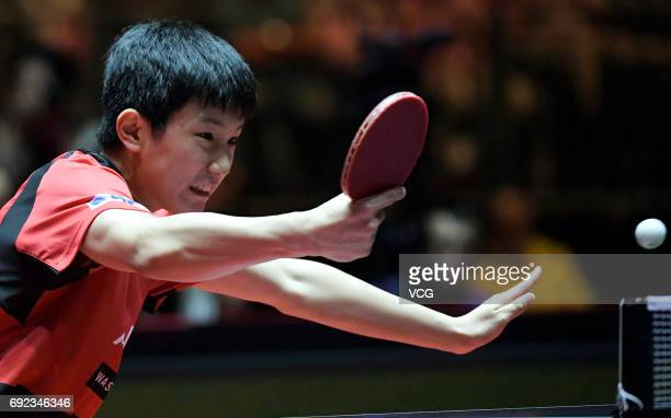 Tomokazu Harimoto of Japan competes during Men's Singles quarterfinal match against Xu Xin of China on day 7 of World Table Tennis Championships at...