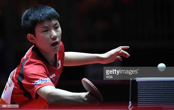 Tomokazu Harimoto of Japan competes during Men's Singles second round match against Jun Mizutani of Japan on day 4 of World Table Tennis...