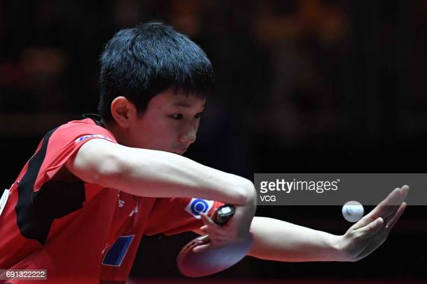 Tomokazu Harimoto of Japan competes during Men's Singles second round match against Jun Mizutani of Japan on day 4 of World Table Tennis...