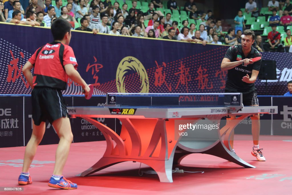 Tomokazu Harimoto (L) of Japan competes during the men's singles first round match against Vladimir Samsonov of Belarus on the day one of the 2017 ITTF World Tour China Open at Sichuan Provincial Gymnasium on June 22, 2017 in Chengdu, China.