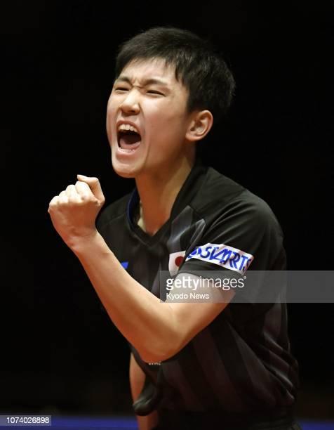 Tomokazu Harimoto of Japan reacts after scoring against Brazil's Hugo Calderano in an ITTF World Tour Grand Finals semifinal match in Incehon South...