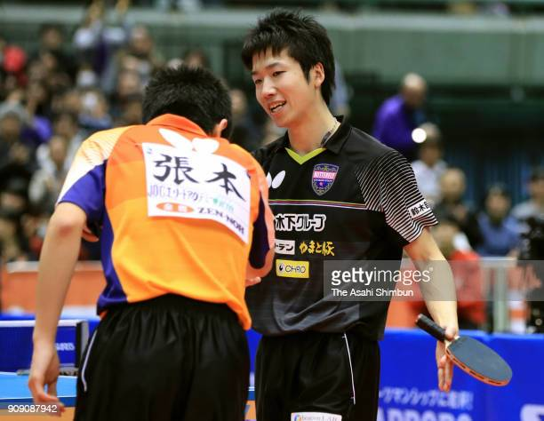 Tomokazu Harimoto shakes hands with Jun Mizutani after winning in the Men's Singles final during day seven of the All Japan Table Tennis...