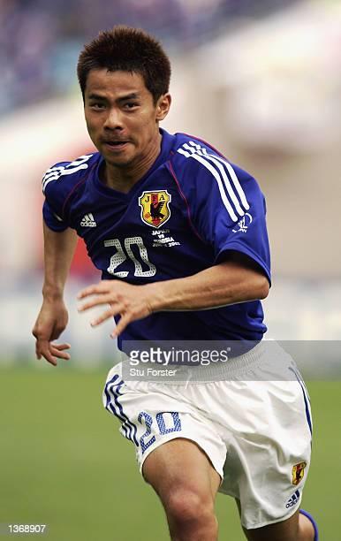 Tomokazu Myojin of Japan in action during the Japan v Tunisia Group H World Cup Group Stage match played at the OsakaNagai Stadium Osaka Japan on...