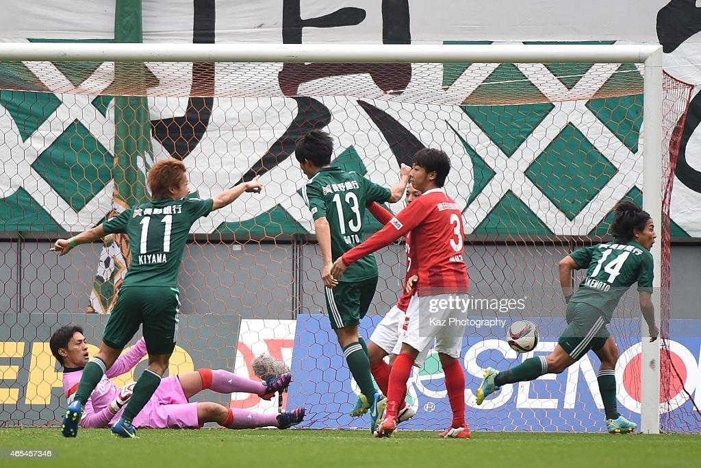 Tomoki Ikemoto of Matsumoto Yamaga scores 2nd goal during the J. League match between Nagoya Grampus and Matsumoto Yamaga at Toyota Stadium on March 7, 2015 in Toyota, Japan.