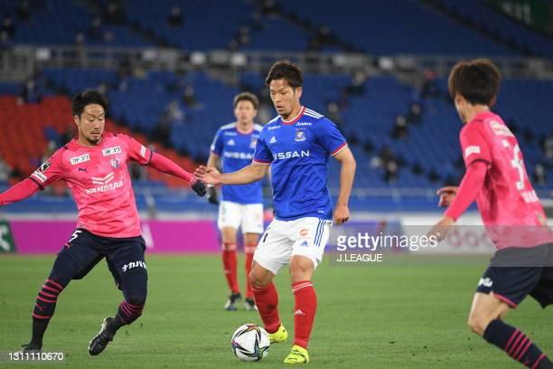 Tomoki IWATA of Yokohama F・Marinos and Naoyuki FUJITA of Cerezo Osaka battle for the ball during the J.League Meiji Yasuda J1 match between Yokohama...