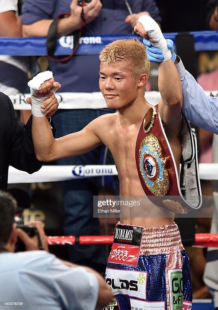 Tomoki Kameda celebrates his seventh-round knockout victory over Pungluang Singyu to retain his WBO bantamweight title at the MGM Grand Garden Arena on July 12, 2014 in Las Vegas, Nevada.