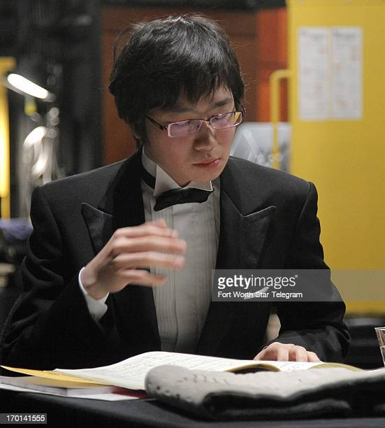 Tomoki Sakata of Japan goes over the score as he gets ready to perform with the Fort Worth Symphony Orchestra under the direction of Leonard Slatkin...