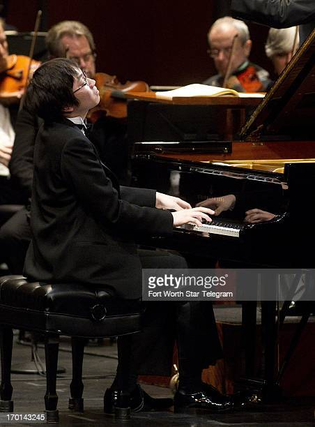Tomoki Sakata of Japan performs with Conductor Leonard Slatkin and the Fort Worth Symphony Orchestra in the finals of the Van Cliburn International...