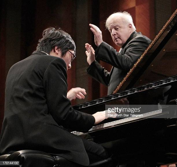 Tomoki Sakata of Japan plays a concerto as Leonard Slatkin conducts the Fort Worth Symphony Orchestra on the second day of finals in the 14th Van...