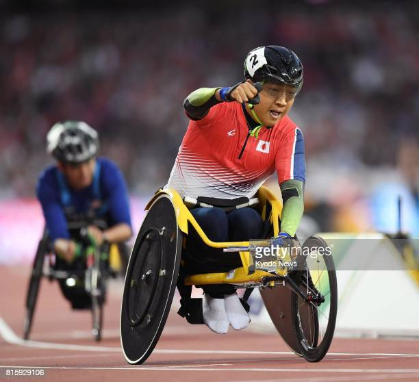 Tomoki Sato of Japan celebrates after winning the men's 1500meter T52 wheelchair race at the World Para Athletics Championships in London on July 16...