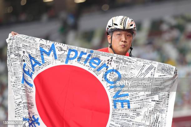 Tomoki Sato of Team Japan celebrates after winning gold in the Men's 400m - T52 Final on day 3 of the Tokyo 2020 Paralympic Games at on August 27,...