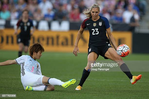Tomoko Muramatsu of Japan controls the ball against Allie Long of United States of America during an international friendly match at Dick's Sporting...