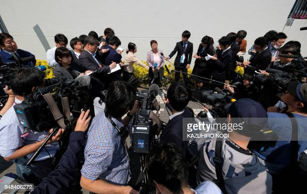 Tomoko Nakagawa the mayor of the western Japanese city of Takarazuka answers questions during a press briefing after submitting her request to the...