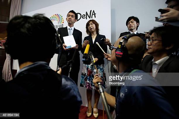 Tomoko Namba, founder and board member of DeNA Co., center, speaks to members of the media as Masatoshi Fukasawa, president of DeNA Life Science...