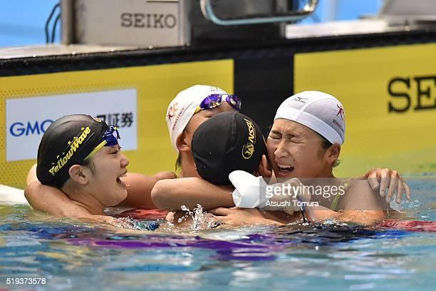 Tomomi Aoki of Japan Sachi Mochida of Japan Chihiro Igarashi of Japan and Rikako Ikee of Japan celebrate after the Women's 200m Freestyle final...