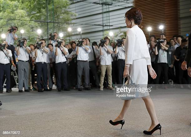 Tomomi Inada newly appointed as defense minister in a Cabinet reshuffle enters the prime minister's office in Tokyo on Aug 3 prior to the attestation...