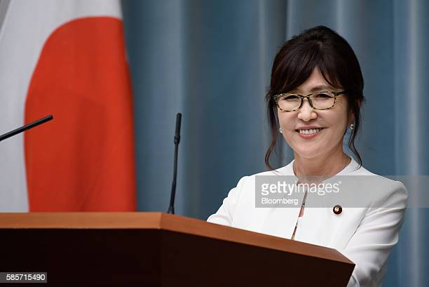Tomomi Inada newly appointed defense minister of Japan smiles during a press conference at the official residence of Japan's Prime Minister Shinzo...