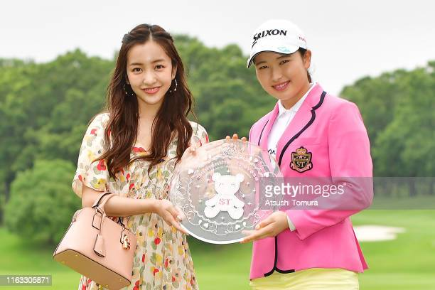 Tomomi Itano of Japan and Sakura Koiwai of Japan pose with the trophy after winning the Thamansa Thavasa Girls Collection Ladies Tournament at the...