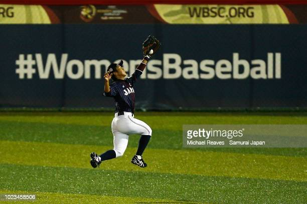 Tomomi Nakada of Japan makes a leaping catch in the seventh inning during the WBSC Women's Baseball World Cup Group B game between Cuba and Japan at...