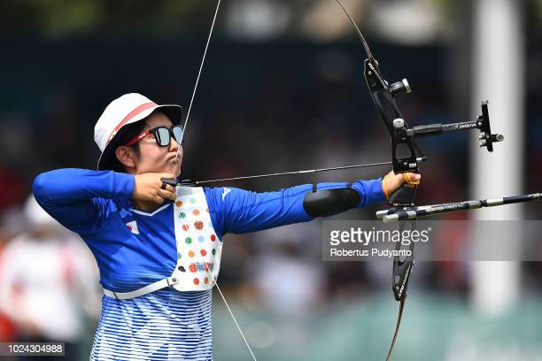 Tomomi Sugimoto of Japan shoots during Recurve Mixed Team Archery Final Rounds on day nine of the Asian Games on August 27 2018 in Jakarta Indonesia