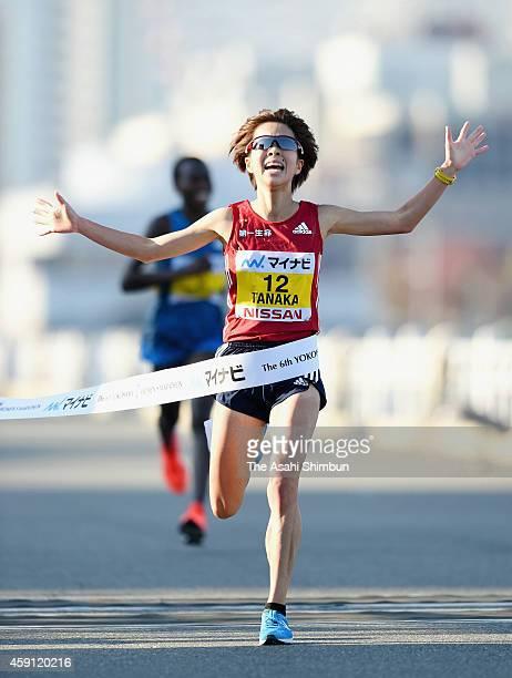 Tomomi Tanaka of Japan crosses the finishing tape to win in the 6th Yokohama International Women's Marathon on November 16 2014 in Yokohama Kanagawa...