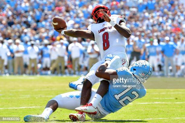 Tomon Fox of the North Carolina Tar Heels pressures Lamar Jackson of the Louisville Cardinals during the game at Kenan Stadium on September 9 2017 in...