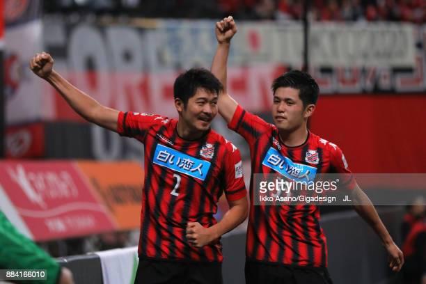 Tomonobu Yokoyama of Consadole Sapporo celebrates scoring his side's third goal with his team mate Ryosuke Shindo during the JLeague J1 match between...