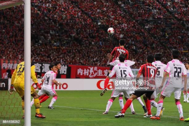 Tomonobu Yokoyama of Consadole Sapporo scores his side's third goal during the JLeague J1 match between Consadole Sapporo and Sagan Tosu at Sapporo...