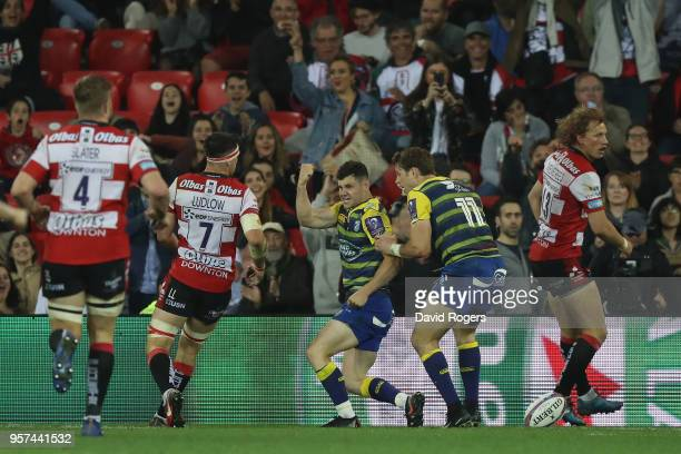 Tomos Williams of Cardiff Blues celebrates after scoring a try during the European Rugby Challenge Cup Final match between Cardiff Blues and...