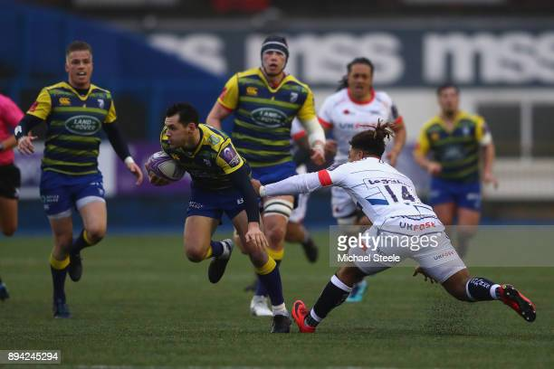 Tomos Williams of Cardiff evades the challenge from Paolo Odogwu of Sale during the European Rugby Challenge Cup Pool Two match between Cardiff Blues...