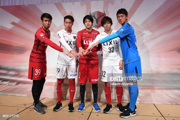 Tomoya Inukai Kazuma Yamaguchi Atsuto Uchida Koki Anzai and Yuya Oki of Kashima Antlers pose for photographers during a Kashima Antlers press...