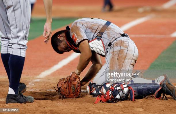 Tomoya Mori of Japan reacts after a collision with Reese McGuire of United States in the seventh inning during the U18 Baseball World Championship...