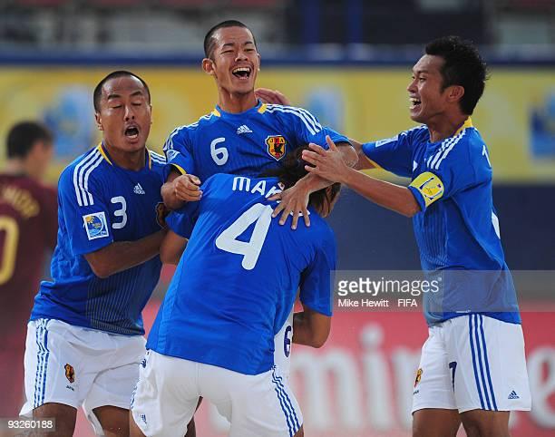 Tomoya Uehara of Japan celebrates with team mates Hirofumi Oda , Shinji Makino and Takeshi Kawaharazuka after scoring during the FIFA Beach Soccer...
