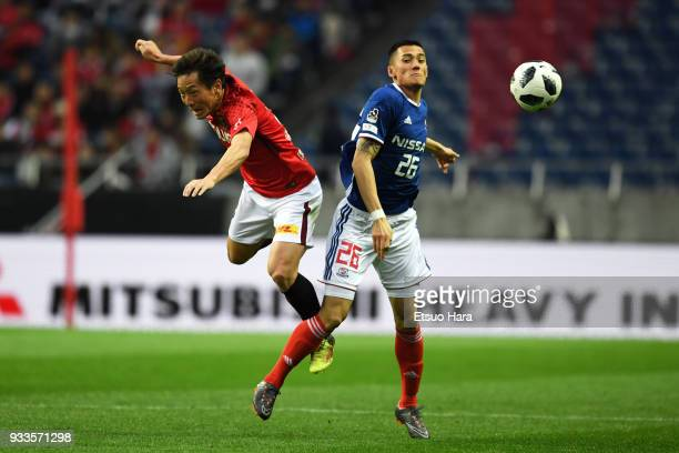 Tomoya Ugajin of Urawa Red Diamonds and Ippei Shinozuka of Yokohama FMarinos compete for the ball during the JLeague J1 match between Urawa Red...